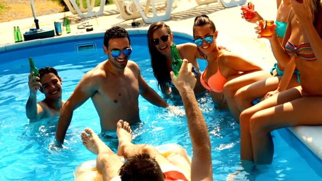 people having fun in a swimming pool. - waist deep in water stock videos & royalty-free footage