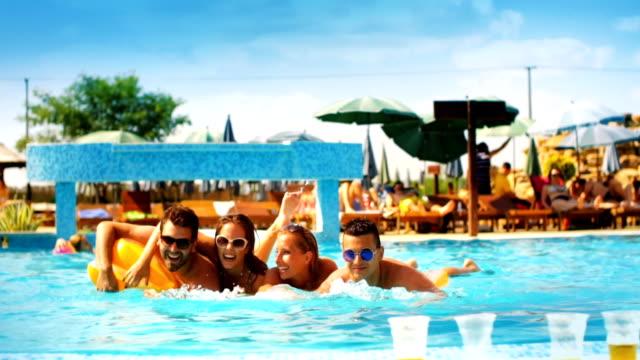 people having fun in a swimming pool - waist deep in water stock videos & royalty-free footage