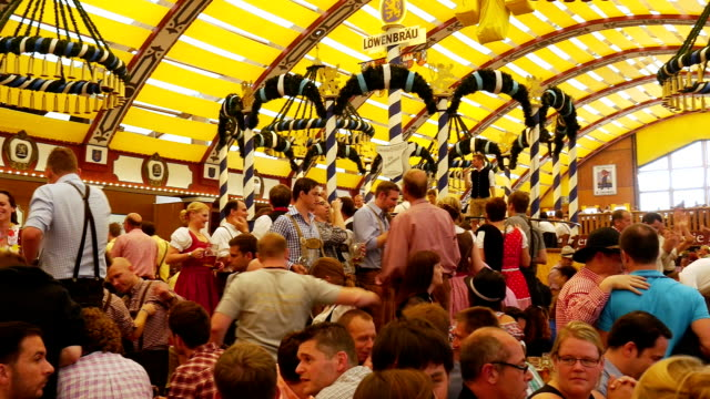 pov t/l people having fun in oktoberfest beer tent - oktoberfest stock videos & royalty-free footage