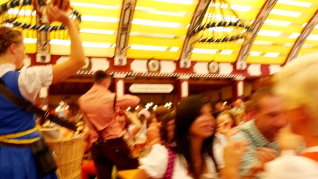 POV T/L People Having Fun In Oktoberfest Beer Tent