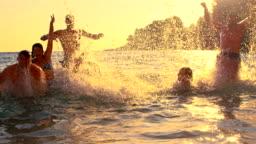 SLO MO People Having Fun In The Sea