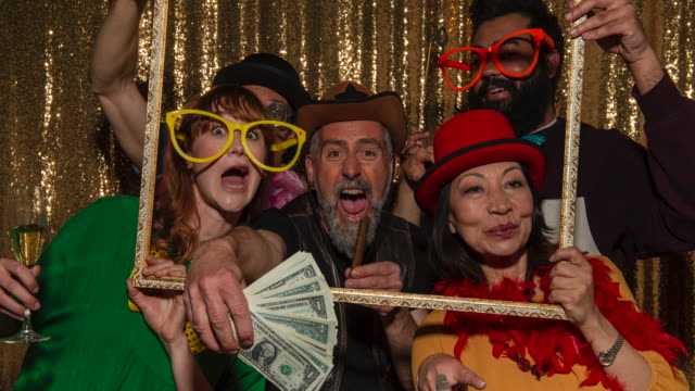 people having fun posing with party props in the photo booth - five people stock videos & royalty-free footage
