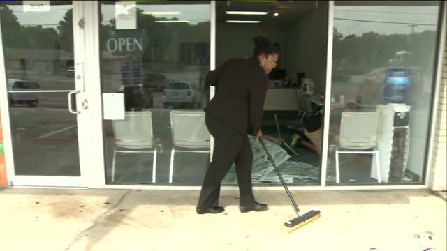 KTVI People Help Clean UP After Mike Brown Shooting Anniversary Protests Lootings on August 10 2015 in Ferguson Missouri