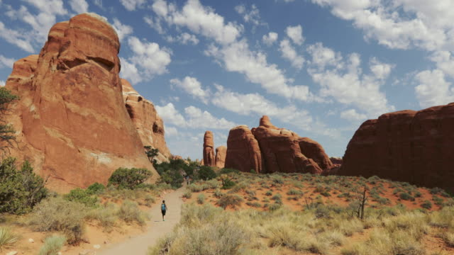 people hiking in arches national park - natural arch stock videos & royalty-free footage