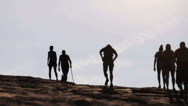 people hiking in mountain landscape, at national park - arches national park stock videos & royalty-free footage