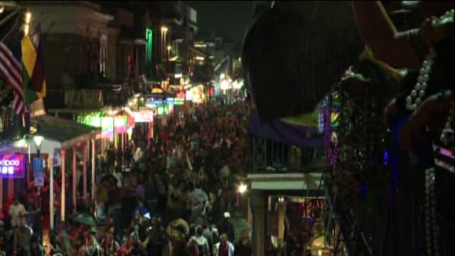 wgno people hit the street for mardi gras on february 12 2013 in new orleans louisiana - gras stock videos and b-roll footage