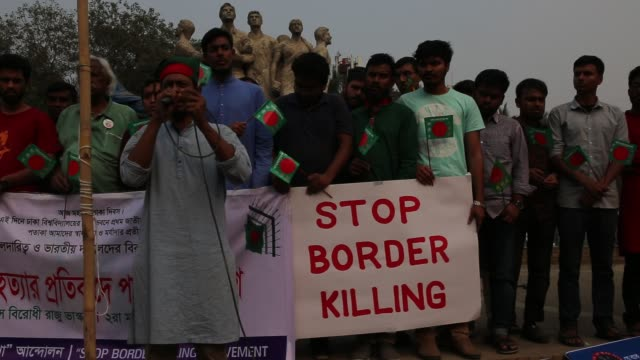 people hold banner and national flag as they participate in a flag protest rally against border killing and demand justice for victims, stop violence... - flag of bangladesh stock videos & royalty-free footage