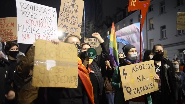 people hold banners, shout slogans and march as they continue to protest against the constitutional court ruling on tightening the abortion law on... - polonia video stock e b–roll