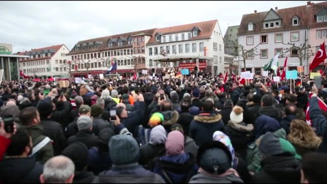 people hold flags and banners during a protest against the racist attack of the far-right extremist who killed nine migrants, 4 of which with turkish... - terrorismus stock-videos und b-roll-filmmaterial