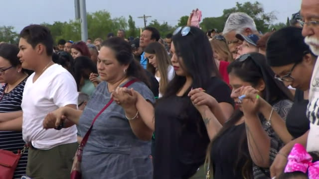 people hold hands at vigil for the victims of the mass shooting in a walmart in el paso, texas - gedenkveranstaltung stock-videos und b-roll-filmmaterial