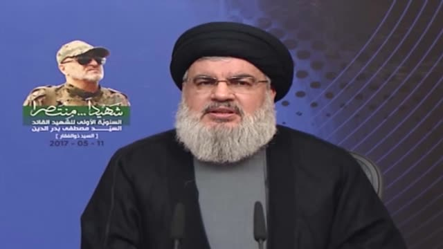 people hold images of mustafa badreddine a soldier of hezbollah killed in syria as secretarygeneral of hezbollah hassan nasrallah live broadcasts... - hezbollah stock videos & royalty-free footage