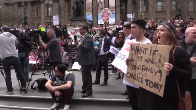 People hold placards during a demonstration to protest accepting so few Syrian and Iraqi refugees in Melbourne Australia on September 12 2015 Leader...