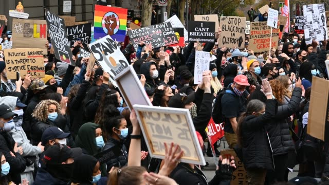 people hold signs and applaud as protesters gather to march in solidarity with protests in the united states against police brutality and in tribute... - unity stock videos & royalty-free footage
