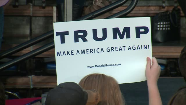 vídeos de stock, filmes e b-roll de wgn people hold trump signs at campaign rally at the prairie capital convention center in springfield illinois on november 9 2015 - 2015