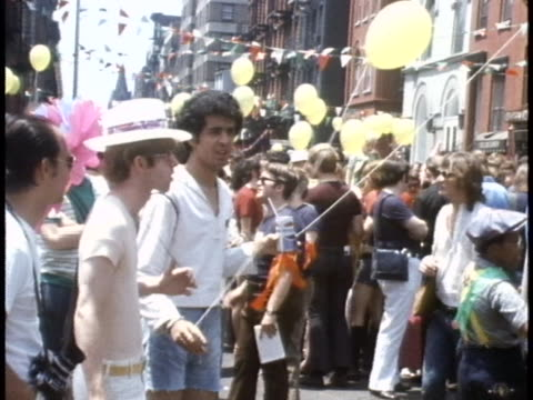 people holding balloons at a 1970s gay rights march in new york city - human rights or social issues or immigration or employment and labor or protest or riot or lgbtqi rights or women's rights stock videos & royalty-free footage