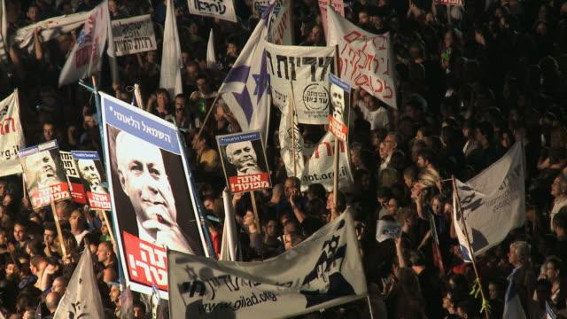 ws people holding baner of kikar hamedina / tel aviv, israel - social justice stock videos & royalty-free footage
