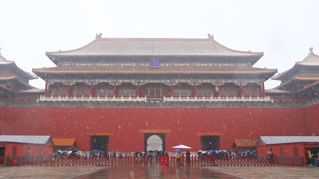 people holding umbrellas visit the forbidden city as the first snow of the season descends upon the city on november 21 in beijing, china. - forbidden city stock videos & royalty-free footage