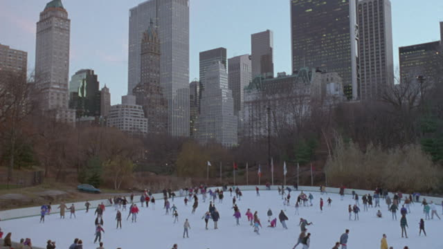 people ice skate in new york city's central park. - ice skating stock videos & royalty-free footage