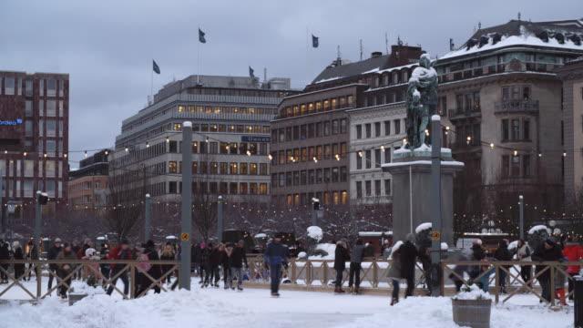 People ice Skating at Kungsträdgården Ice Rink in Stockholm, Sweden