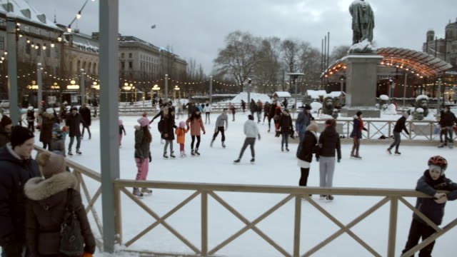 people ice skating in kungstradgarden / stockholm, sweden - ice skating stock videos & royalty-free footage