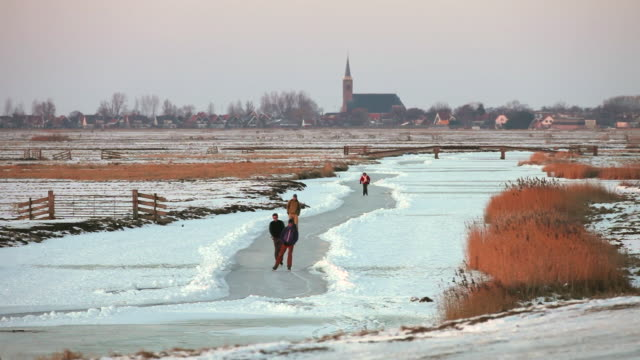stockvideo's en b-roll-footage met people ice skating in polder, schermerhorn, netherlands - nederland