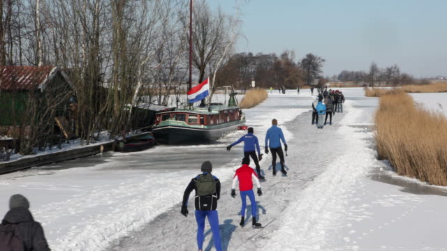 people ice skating in polder - polder stock videos and b-roll footage