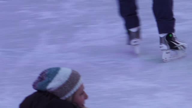 People ice skating in Vienna Austria