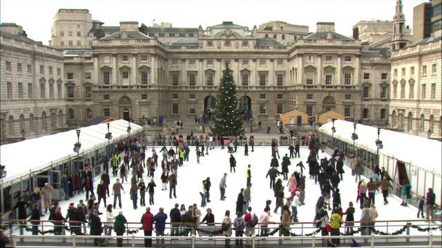 ws zo zi people ice-skating at somerset house / london, united kingdom - ice rink stock videos & royalty-free footage