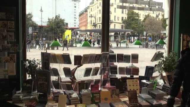 people in a bookstore in sweden react after the swedish academy forced to skip last year's nobel literature prize over a sexual harassment scandal... - nobel prize in literature stock videos & royalty-free footage