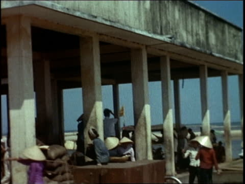 people in a building by a beach / people on a beach / boy standing by a column / family eating - natural column stock videos and b-roll footage