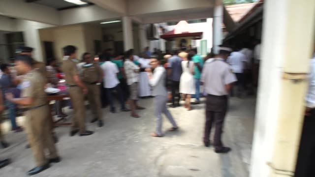 People in a morgue in Colombo attempting to identify victims of deadly terror attacks on Churches and hotels in Sri Lanka