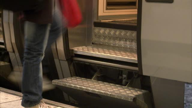 vídeos de stock, filmes e b-roll de people in a train sweden. - unknown gender