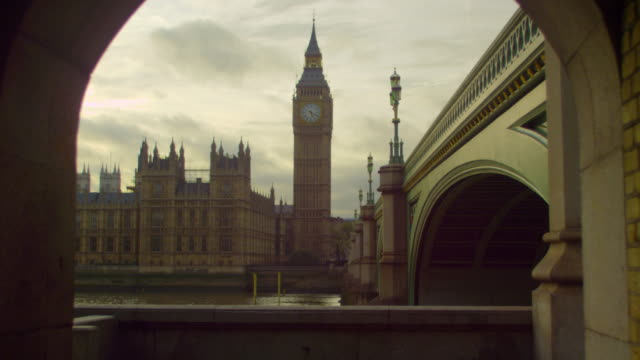 people in a tunnel across westminster and big ben - clock tower stock videos & royalty-free footage
