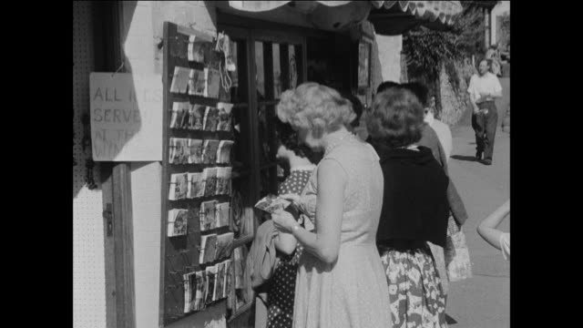 montage people in a u.k. national park shop for postcards / uk - postcard stock videos and b-roll footage