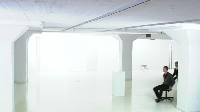 people in a white and empty office premises sweden. - chair stock videos and b-roll footage