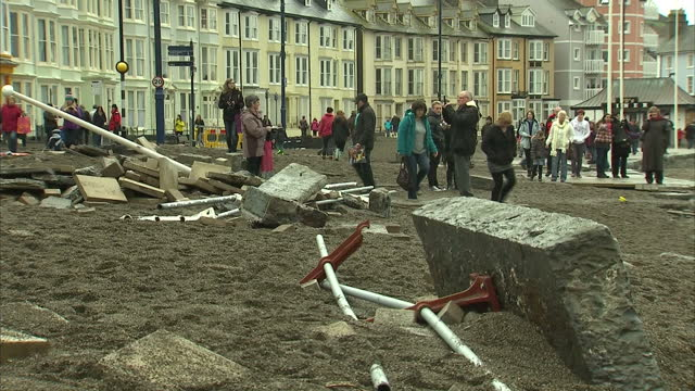 people in aberystwyth in west wales were clearing after last night's tidal surge breached the sea wall and forced one hundred students from the... - aberystwyth stock videos & royalty-free footage