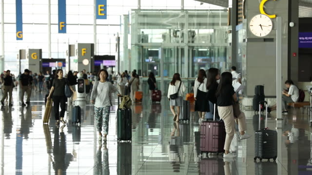 people in airport terminal at incheon international airport in incheon, south korea, on wednesday, august 7, 2019. - passagier stock-videos und b-roll-filmmaterial