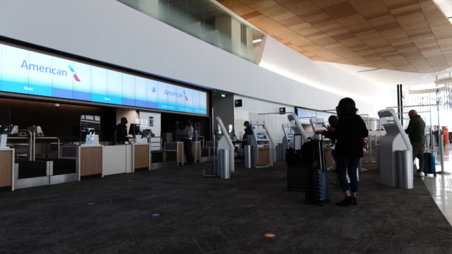people in american airlines check-in area at san francisco international airport in san francisco, california, u.s., on thursday, october 1, 2020. - san francisco international airport stock videos & royalty-free footage