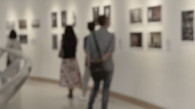 people in art gallery - exhibition stock videos & royalty-free footage