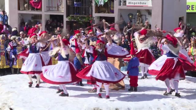 people in austria's nassereith dress up in traditional costumes for a carnival which dates back some 270 years and celebrates the end of the winter - austrian costume stock videos and b-roll footage