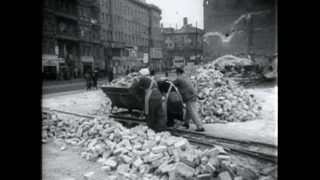 people in berlin push cart full of rubble from ww2 bombs; 1949 - ruined stock videos & royalty-free footage