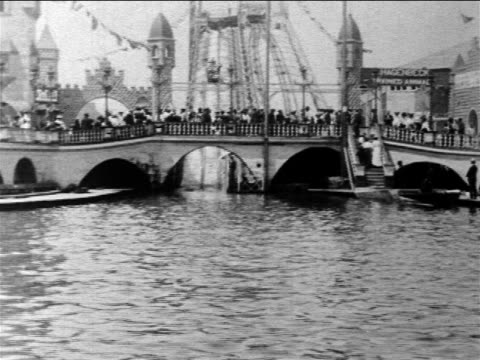 b/w 1903 people in boat coming down flume in amusement park ride / coney island - coney island brooklyn stock videos & royalty-free footage