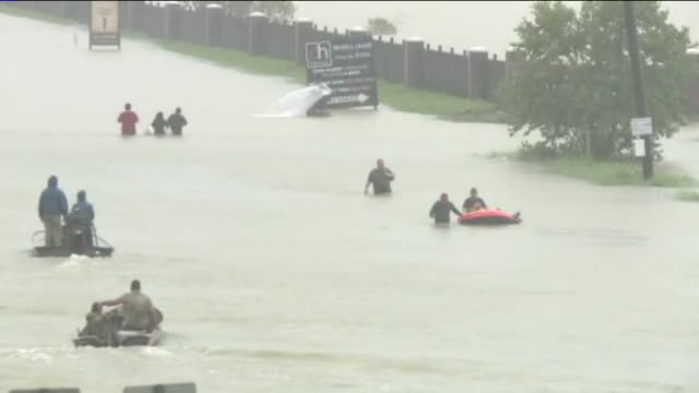 people in boats, escaping flood water after hurricane harvey on east sam houston pkwy in houston, texas, aug. 28, 2017. - east stock videos & royalty-free footage