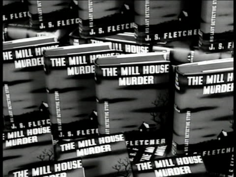 vídeos de stock, filmes e b-roll de people in book store crime fiction display 'the mill house murder' female salesclerk moving display books cu 'crime club books sold here' sign male... - livraria