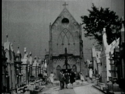 1929 b/w montage people in cemetery / new orleans, louisiana - 1920 1929 stock videos and b-roll footage