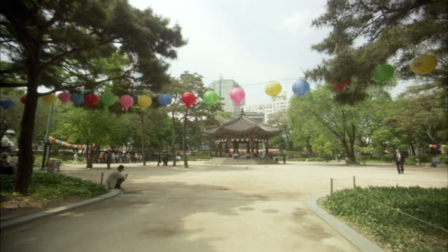 ws zi people in city park with hanging lantern, seoul, south korea - gazebo stock videos and b-roll footage