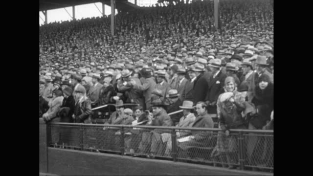 ws pan people in coats and hats watching baseball game and cheering in stadium / united states - sport venue stock videos & royalty-free footage