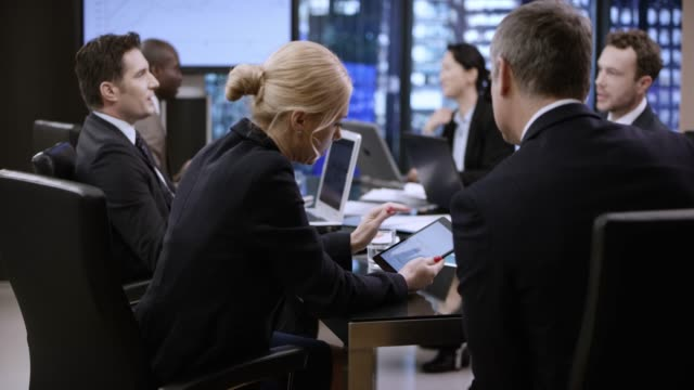 people in conference room chatting while waiting for meeting to start. shot in slovenia. - full suit stock videos & royalty-free footage