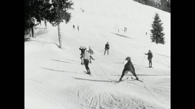 people in costume ski downhill during fasching; 1966 - letterbox format stock videos & royalty-free footage