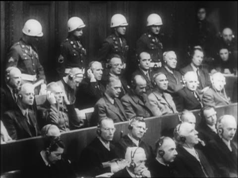 b/w 1946 people in courtroom for nazi war crimes trials with headphones on / nuremberg / newsreel - 1946 stock videos and b-roll footage